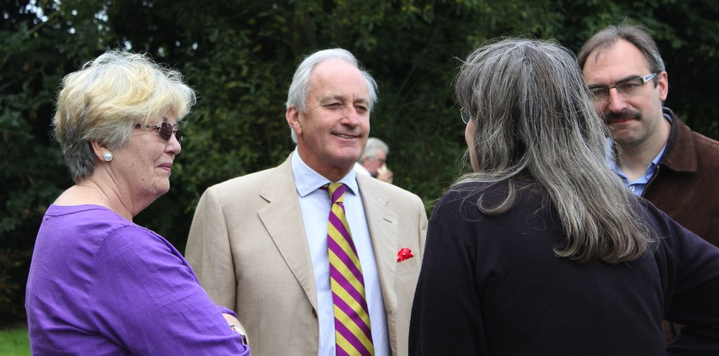 neil hamilton chatting with guests
